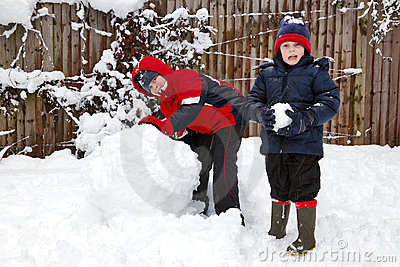 Two Boys Playing In The Snow Royalty Free Stock Image - Image: 17213316