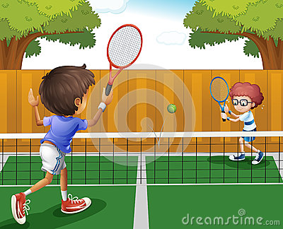Two boys playing tennis inside the fence