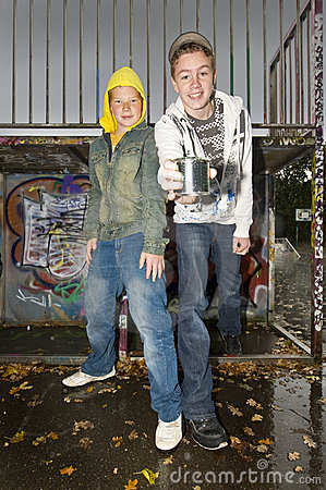Two boys showing a can