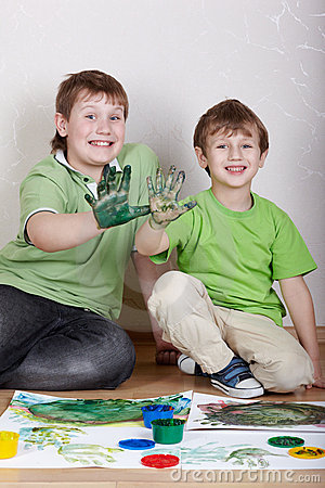 Two boys sit with satisfied faces and show palms