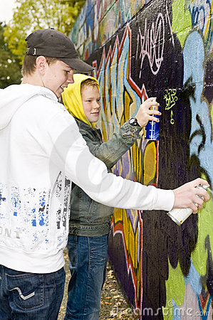 Two boys spray painting