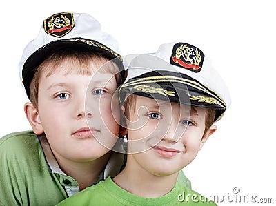 Two boys in white sea peak-caps