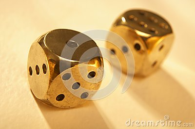 Two brass dice