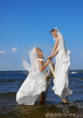Two brides on stepladder