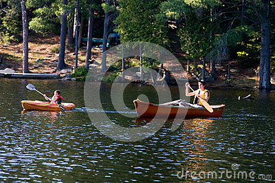Two brother out paddling on the lake