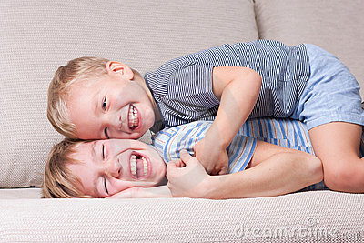 Two brothers laugh.