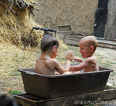 Two brothers play and to wash