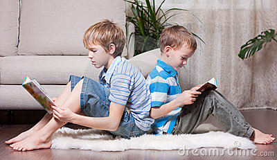 Two brothers are reading books.