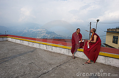 Two Buddhist Monks Talking on a Roof Editorial Photo