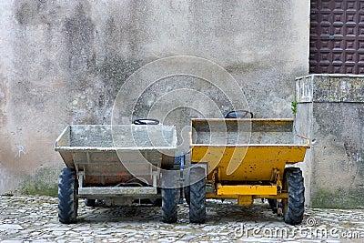 Two builders dumper trucks side by side