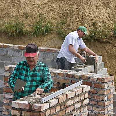 Two builders making walls