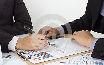 Two business men review the documents