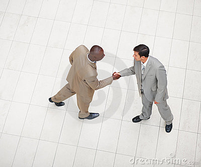 Two business men shaking hands with eachother