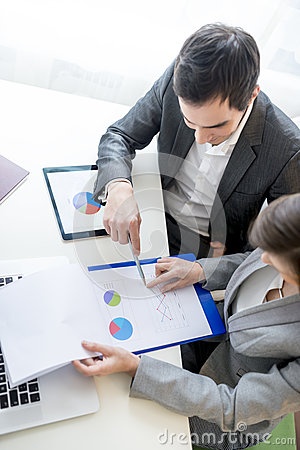 Free Two Business Partners Analysing A Report Stock Images - 78029514