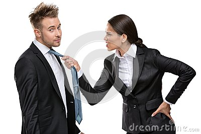 Two business people debate and fight