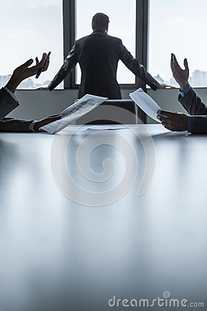 Free Two Business People Discussing And Gesturing Over The Table While Another Looks Out The Window, Hands Only Royalty Free Stock Photo - 33402995
