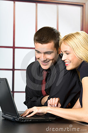 Two business people on laptop