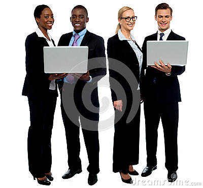 Two business teams posing with laptop