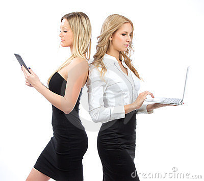 Two business woman with tablet and laptop