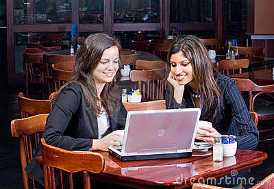 Two business women in cafe