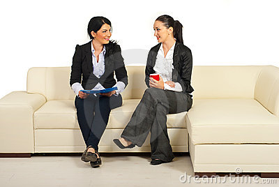 Two business women having conversation