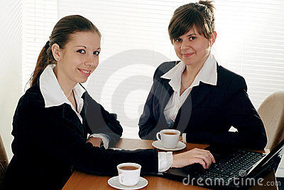 Two business women sitting