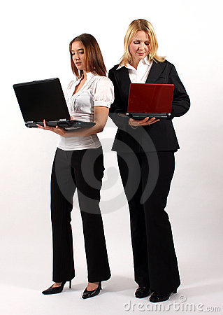 Two Business Women Standing with Laptops
