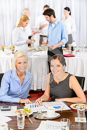 Free Two Business Women Work During Catering Buffet Royalty Free Stock Image - 24891536