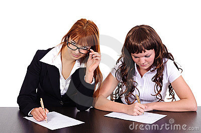 Two business women working together