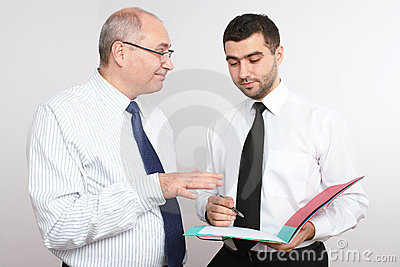 Two businessman discuss something.