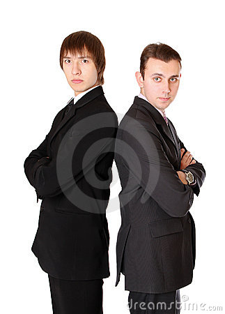 Two businessman standing back to back