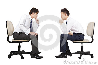 Two businessman thinking and looking