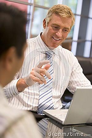 Two businessmen in boardroom