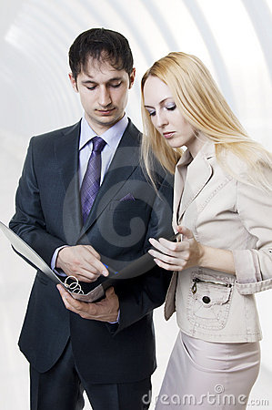 Two businessmen discussing in modern hall