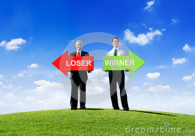 Two Businessmen Holding Loser and Winner