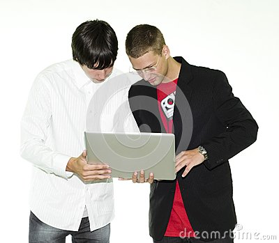 Two businessmen looking at laptop
