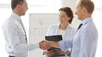 Two businessmen shaking their hands. Business handshake - two businessmen shaking their hands