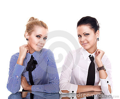 Two businesswoman siting on reflection table