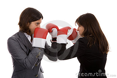 Two businesswomen with boxing gloves fighting