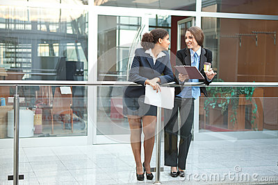 Two businesswomen chatting
