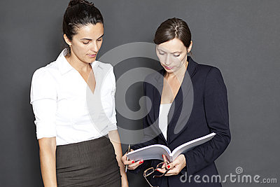Two businesswomen with paper work