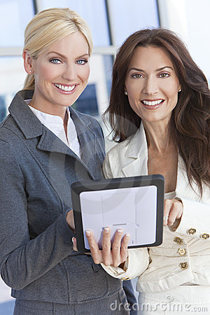 Two Businesswomen or Women Using Tablet Computer