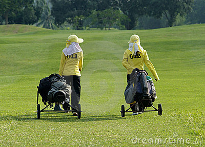 Two caddies on a golf course