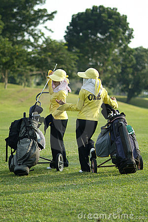 Two caddies at a golf course