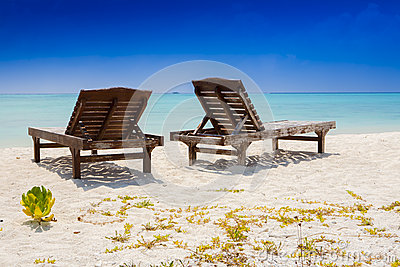 two canvas chairs at the beach
