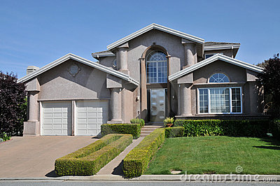 Two car garage house with decorative schrubs stock photo for Two story garages for sale