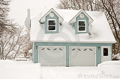 Two car garage in snowstorm