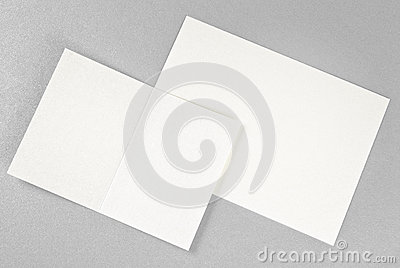 Two cards over silver background