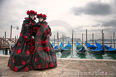Two carnival Masks in San Marco, Venice.