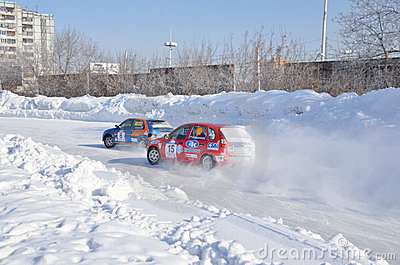 Two cars compete at the turning the track Editorial Photo